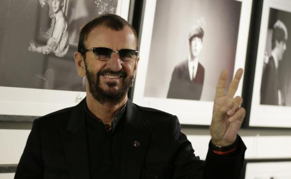 Pop icon and former Beatle Ringo Starr poses for the media in front of some of his photographs as he launches a book, Photograph, in London on Wednesday.