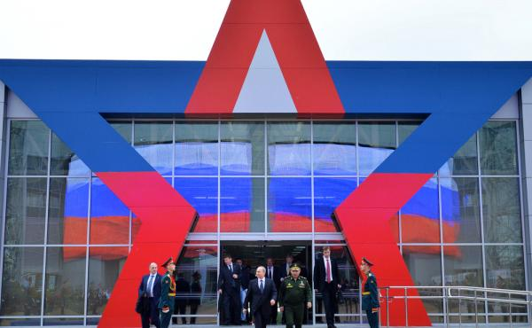 Russian President Vladimir Putin (center left) and Defense Minister Sergei Shoigu (center right) arrive for the opening of the Army-2015 international military show outside Moscow in June.