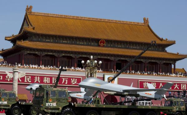 Military vehicles carrying Wing Loong — a Chinese-made, medium-altitude, long-endurance, unmanned aerial vehicle — drive past Tiananmen Gate during a military parade to commemorate the 70th anniversary of Japan's World War II defeat in Beijing o
