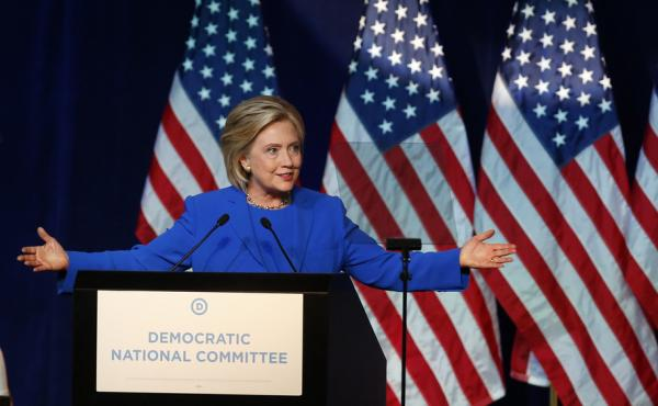 Hillary Clinton speaks at the Democratic National Committee's summer meeting in Minneapolis, where she was trying to court all-important party delegates to her side.
