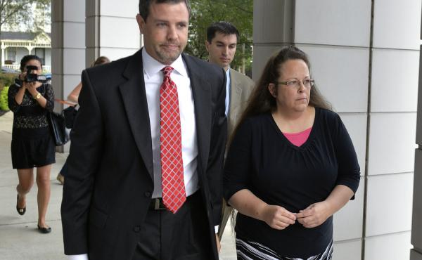 Rowan County Clerk Kim Davis as she goes into the U.S. District Court in July with her lawyer. Davis says that issuing same-sex marriage licenses violates her religious beliefs.
