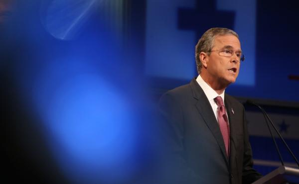 Former Florida Gov. Jeb Bush speaks during the first Republican presidential debate Thursday in Cleveland. Bush touted his jobs record in Florida.