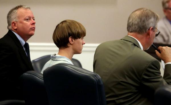 Dylann Roof, seen here at a recent court hearing in Charleston, S.C., will face federal hate crime charges over a mass shooting that police say he carried out at a black church.