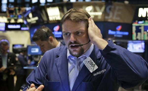 Traders work on the floor at the New York Stock Exchange in New York before trading was halted on Wednesday.