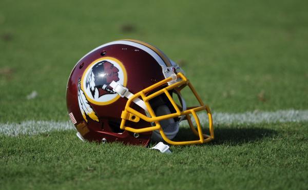 A Washington Redskins football helmet lies on the field during NFL football minicamp.