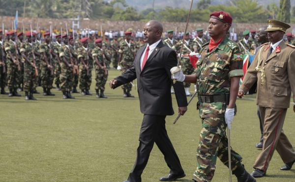 Burundi's President Pierre Nkurunziza walks with military officials during the country's Independence Day on Wednesday. Despite criticism at home and abroad, the president is defying a two-term limit and running for a third term in an election set for the