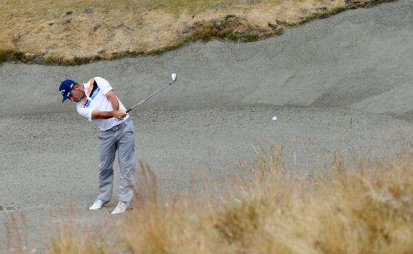 Matt Every hits out of the bunker on the seventh hole during the first round of the U.S. Open golf tournament at Chambers Bay.