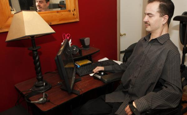 Brandon Coats works on his computer at his home in Denver in December 2012.