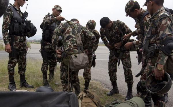 Nepali army soldiers prepare for a rescue mission to the downed U.S. helicopter on Friday. Officials say the remains of all eight aboard the Huey UH-1 have been recovered.