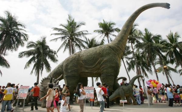 A life-size replica of a Brontosaurus towers above park goers on Christmas day in 2006 in Manila, Philippines.
