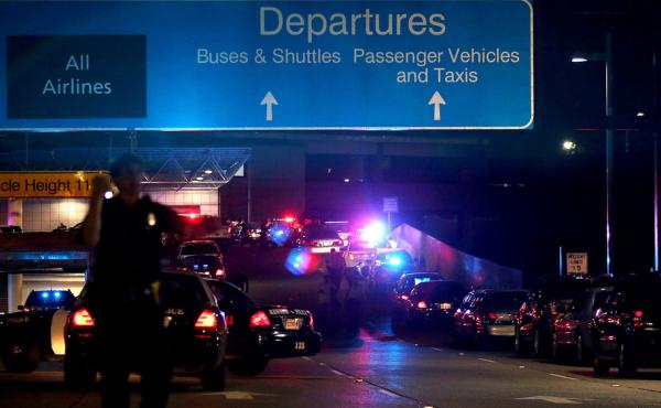 The ramp to departures is blocked by emergency vehicles at the New Orleans International Airport on Friday night in Kenner, La.