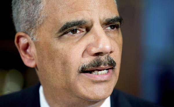 Attorney General Eric Holder denounces the shootings of Ferguson, Mo., officers and announces six pilot cities for a community trust and justice initiative.