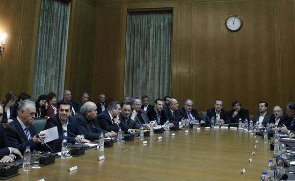 Greek Prime Minister Alexis Tsipras (fourth from the left) leads the first cabinet meeting of his government Jan. 28 in Athens. He's been criticized for selecting no women for senior positions.