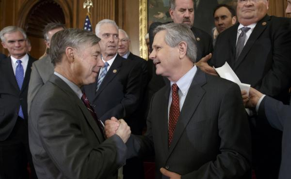House Energy and Commerce Committee Chairman Fred Upton, R-Mich., left, clasps hands with Sen. John Hoeven, R-N.D., sponsor of the Senate's Keystone XL pipeline bill version, on Wednesday as lawmakers gather to urge President Obama to sign the legislation