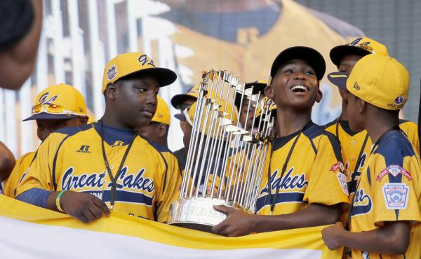 In this Aug. 27 photo, members of the Jackie Robinson West Little League baseball team participate in a rally in Chicago celebrating the team's U.S. Little League Championship. Little League International has stripped the team of its national title after