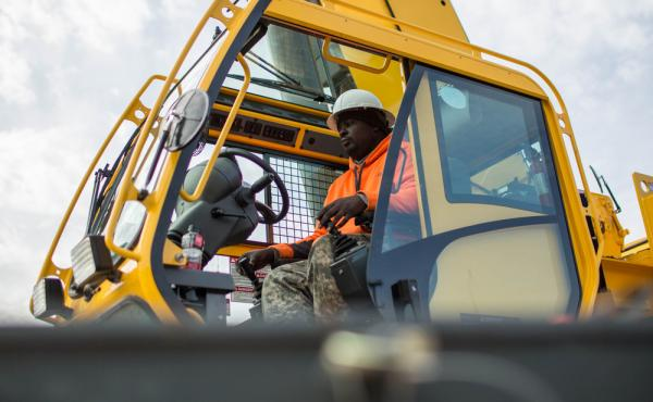 Former student Nathaniel Simmons operates a crane during a day of training at Georgia College of Construction. The Department of Labor says construction was one of several sectors that showed job gains in December.