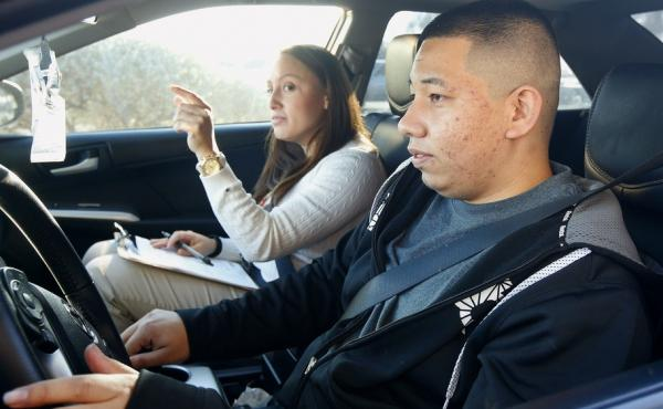 Ramon Maldonado takes his driving test with the Arizona Department of Transportation Motor Vehicle Division. Many young immigrants protected from deportation under the Obama administration's new policies began pursuing driver's licenses in the state Monda