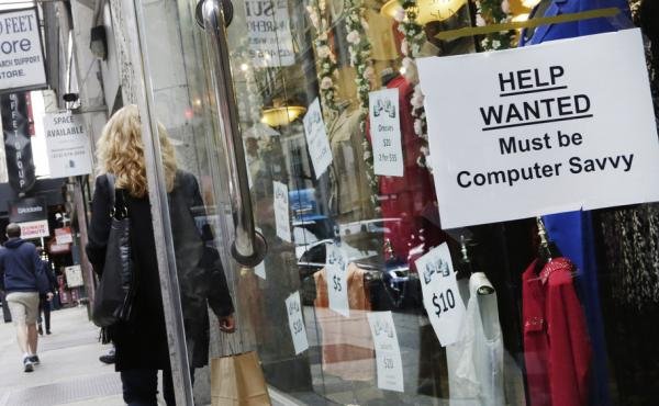 A shopper walks past a store with a