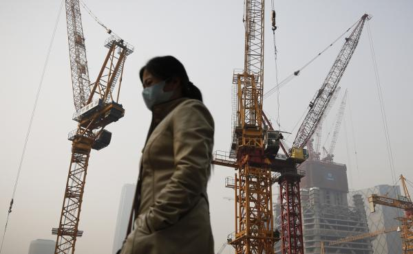 Beijing's chronic high pollution has forced residents to adjust to living with the haze. China is the world's biggest greenhouse gas emitter, but until recently, the government treated air pollution and climate change as separate issues, saying climate ch