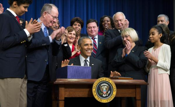 President Obama smiles Thursday after signing the Every Student Succeeds Act, a major education law setting U.S. public schools on a new course of accountability.