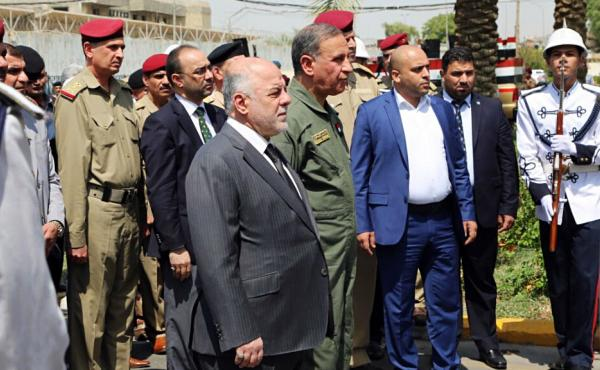 Iraqi Prime Minister Haider al-Abadi (center) attends a funeral for two generals killed in fighting with Islamic State militants in Ramadi, west of Baghdad, in August. In an interview Monday with NPR, the Iraqi leader called on the U.S. to provide more ai
