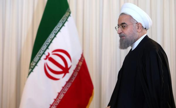 Iran's President Hassan Rouhani leaves after a televised speech in Tehran on Dec. 16. Iran has been dismantling parts of its nuclear program as required under an international deal, and some sanctions could be lifted as soon as January.