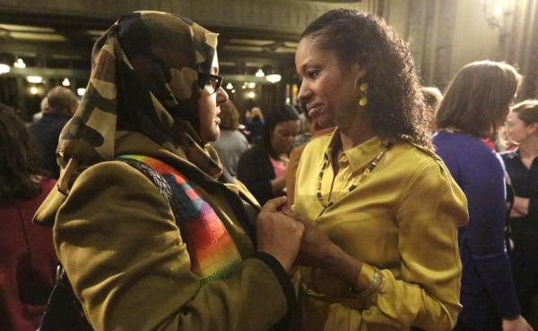 Former Wheaton College professor Larycia Hawkins (right) is greeted by supporter Donna Demir after a news conference on Jan. 6 in Chicago. Hawkins, who's Christian, was suspended by Wheaton, an evangelical Christian school, after she said Muslims and Chri
