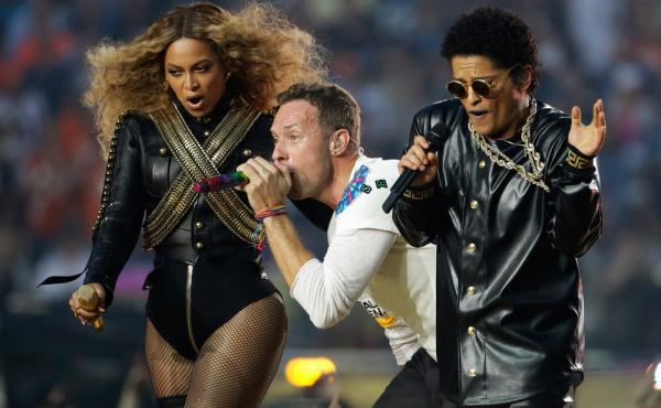 Beyoncé, Coldplay singer Chris Martin and Bruno Mars perform during halftime of the NFL Super Bowl 50 football game Sunday, Feb. 7, 2016, in Santa Clara, Calif.