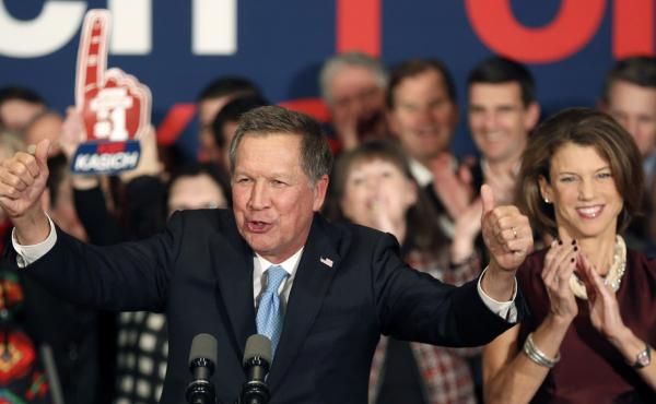 Ohio Gov. John Kasich, with his wife, Karen Waldbillig, at his side, cheers with supporters Tuesday at his Republican primary night rally in Concord, N.H.