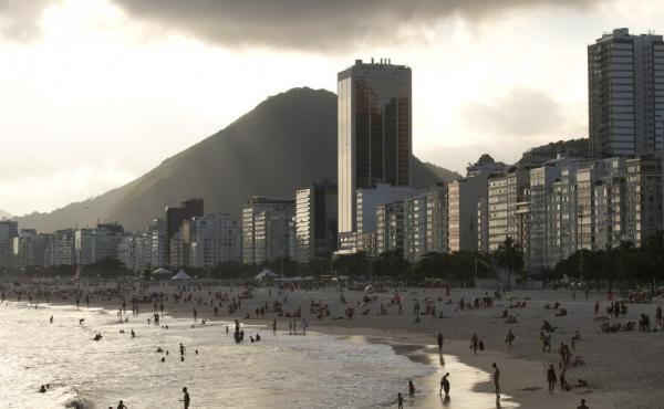 Hotels and apartment buildings line the Copacabana beach in Rio de Janeiro, Brazil. The head of a sports travel agency specializing in packages for the Rio 2016 Olympics said that the company's business could be devastated if the Zika virus continues to s