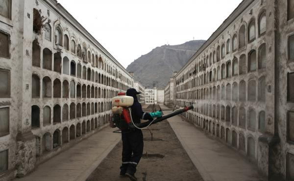 A health worker in Lima, Peru, fumigates against the mosquito that spreads Zika virus, dengue and chikungunya.