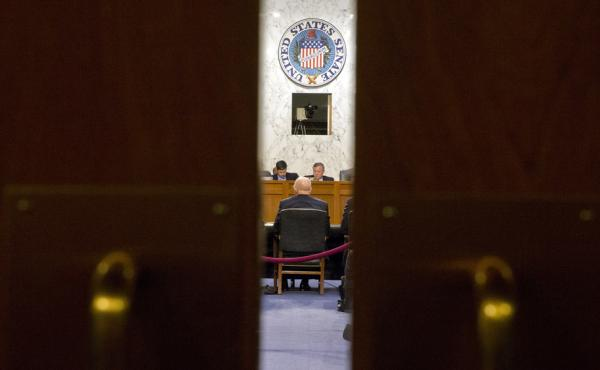 Director of the National Intelligence James Clapper, seated at the table meets with the Senate Intelligence Committee Feb. 9, including Chairman Richard Burr, R-N.C. Burr and the committee's minority leader, Sen. Dianne Feinstein, D-Calif., are working on