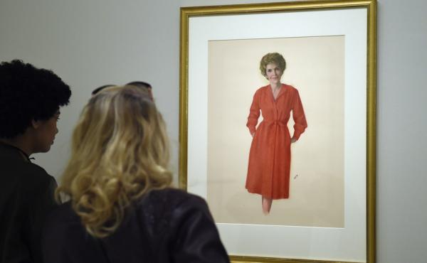 Two women look at a portrait of Nancy Reagan hanging in the National Portrait Gallery in Washington, D.C., on Monday.