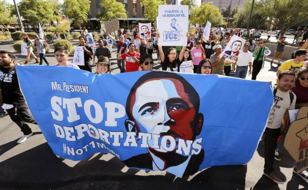 Hundreds protest President Barack Obama's immigration policy, marching to the U.S. Immigration and Customs Enforcement office in Phoenix in 2013. Many Latinos who supported the president have become frustrated by his administration.