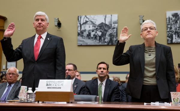 Michigan Gov. Rick Snyder and EPA Administrator Gina McCarthy are sworn in to testify before the House Oversight and Government Reform Committee hearing in Washington on Thursday.