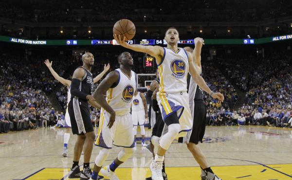 Golden State Warriors' Stephen Curry drives to the hoop during Thursday's game against the San Antonio Spurs. The Warriors won 112-101.