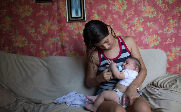 Angelica Pereira feeds her daughter Luiza, who was born with microcephaly, at her mother's house in Santa Cruz do Capibaribe, Brazil.