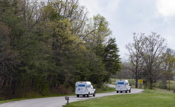 Crime scene investigation vehicles drive to the location of a multiple shooting in Pike County, Ohio, on April 22.
