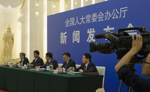 Chinese officials answer questions about a new law regulating overseas nongovernmental organizations during a press conference at the Great Hall of the People in Beijing on Thursday. The new law subjects NGOs to close police supervision.