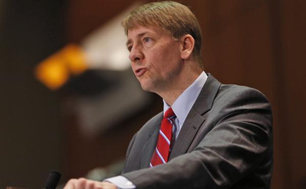Consumer Financial Protection Bureau Director Richard Cordray says financial firms use arbitration to