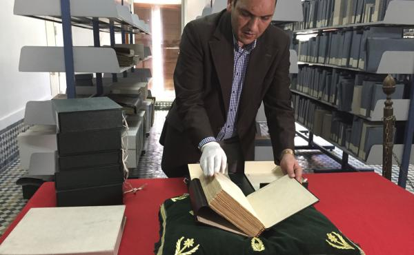 The curator of the Qarawiyyin Library, Abdelfattah Bougchouf, opens an original version of a famous work, Muqaddimah, written by historian Ibn Khaldun in the 14th century. The library in Fez is one of the world's oldest working libraries, dating to the 10