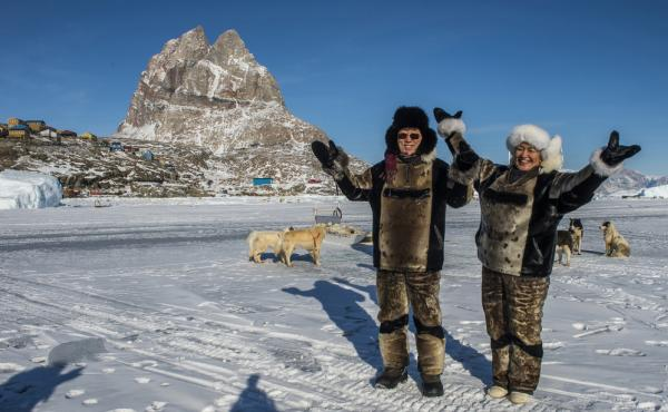 U.N. Secretary-General Ban Ki-moon (left) and Greenland's then-Prime Minister Aleqa Hammond stand on the ice outside the city of Uummannaq, north of the Arctic Circle, in 2014. Greenland held a referendum in 1982 and voted to leave the European Economic C