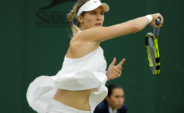 Eugenie Bouchard of Canada returns to Magdalena Rybarikova of Slovakia. Bouchard says she likes the loose fit of the controversial NikeCourt Premier Slam dress.
