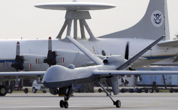 Since President Obama took office in 2009, the Predator drone and other aircraft have carried out nearly 500 strikes in areas that aren't in combat zones such as Syria and Afghanistan, according to a new official report.