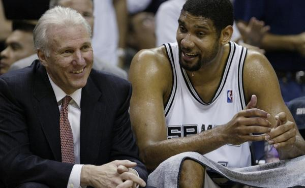 San Antonio Spurs player Tim Duncan with Spurs coach Gregg Popovich, left. The two won more games than any other coach-player pair in NBA history. Duncan announced today he is retiring after 19 seasons with the team.