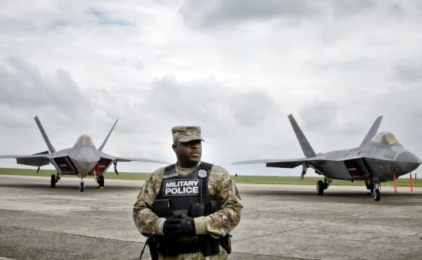 A U.S. military policeman stands in front of Air Force fighter jets that were part of a NATO show of strength in Romania in April intended to deter Russian intervention in Ukraine.