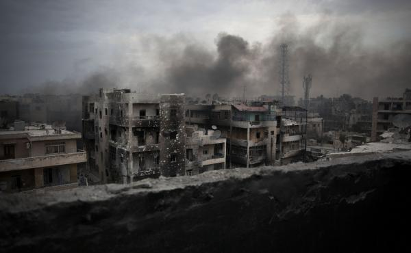 Smoke rises over Saif Al Dawla district in Aleppo, Syria, in 2012. Russia and the Syrian government say they will open humanitarian corridors in Aleppo and offer a way out for opposition fighters wanting to lay down their arms, Russian Defense Minister Se