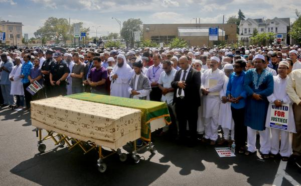 Thousands gather to pray at caskets of Imam Maulama Alauddin Akonjee and Thara Uddin on Monday in New York. Both were shot as they left a mosque in Queens following afternoon prayers Saturday.
