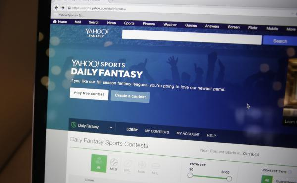 A laptop screen displays the new Yahoo Sports Daily Fantasy contest during a product launch in 2015.