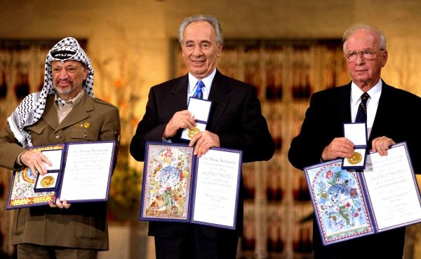 Israeli Prime Minister Yitzhak Rabin (right) was awarded the Nobel Peace Prize along with his foreign minister Shimon Peres (center) and Palestinian leader Yasser Arafat in 1994. Rabin signed an agreement with the Palestinians that launched negotiations b